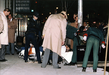 Cops & FBI Agents Surround The Body Of Paul Castellano